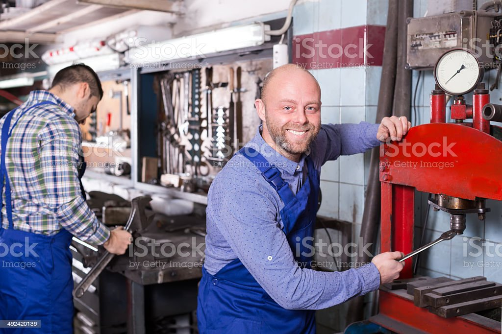 Men at work in workshop stock photo