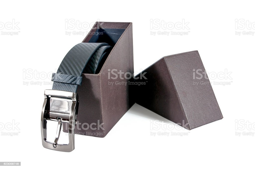 Men belt in a brown box isolated on white background stock photo