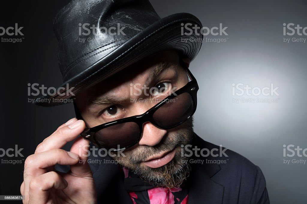Men by shifting the sunglasses have a greeting stock photo