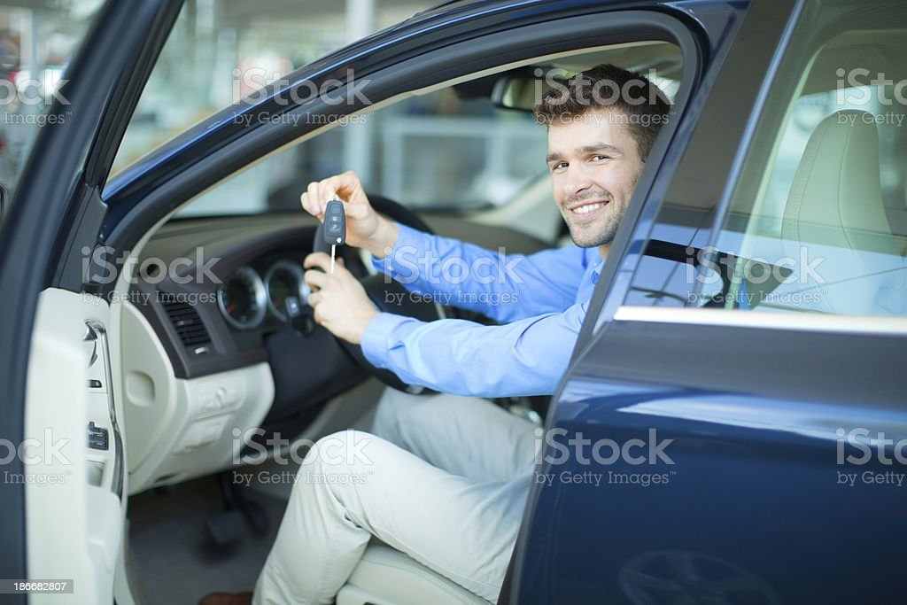Men bying car. royalty-free stock photo