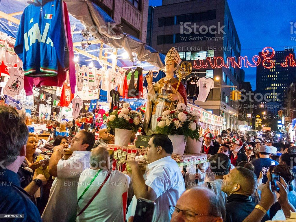 Men carry a effigy of San Gennaro along Mulberry Street stock photo