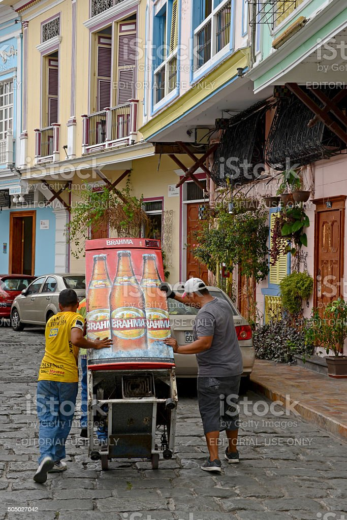 Men carrying a beer vending machine stock photo