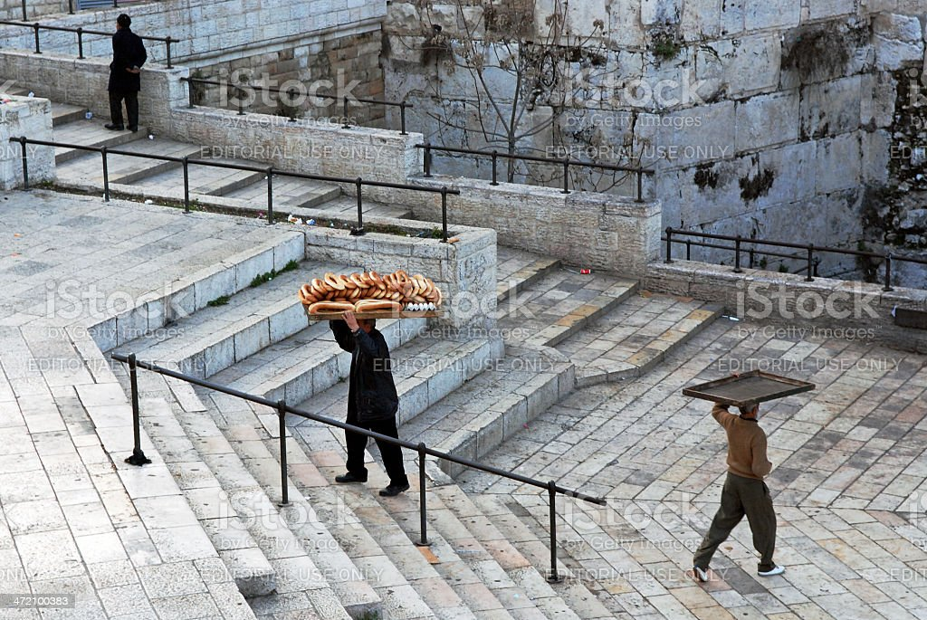 Men carrying racks for bread on their heads. royalty-free stock photo