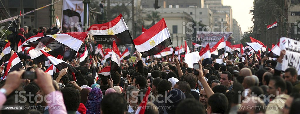 Men celebrating Mubarak's step down in Tahrir sq. stock photo