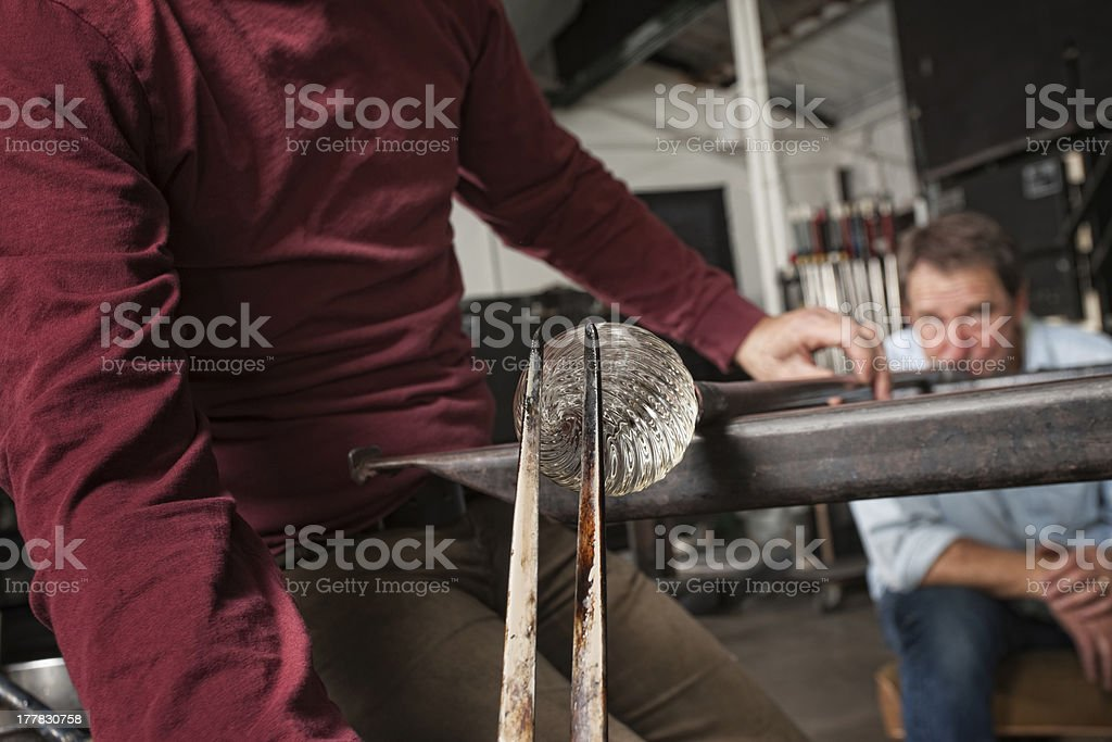 Men Creating Clear Glass Object stock photo