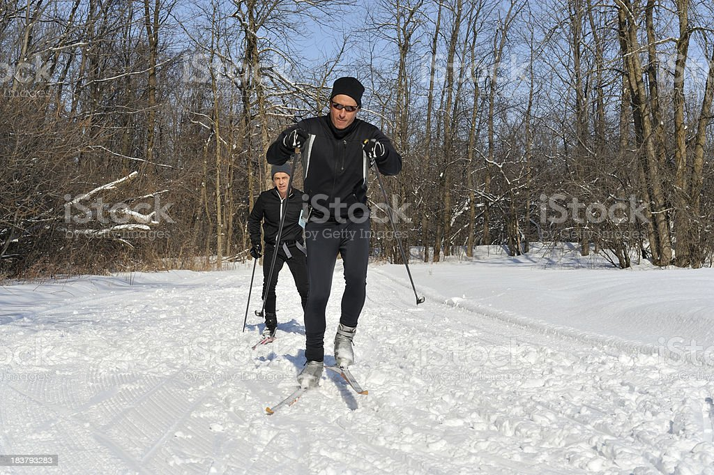 Men cross-country skiing, winter sport, royalty-free stock photo