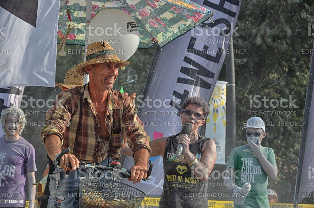 Men cycling have fun at The Color Run stock photo