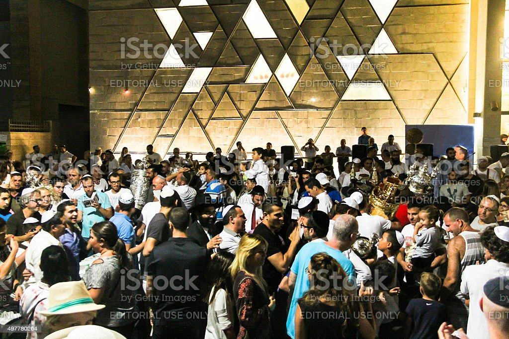 Men dance with Bible scrolls at Simhath Torah. Tel Aviv stock photo