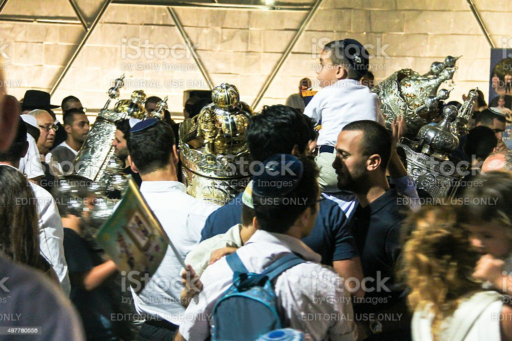 Men dance with Bible scrolls during  ceremony of Simhath Torah stock photo
