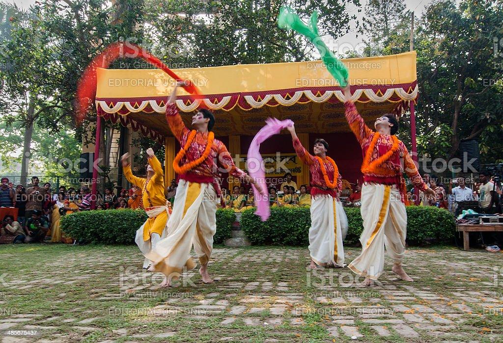 Men dancers performing in Holi celebration, India royalty-free stock photo