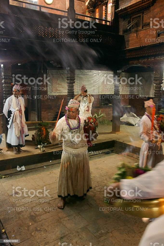 men dancing in Navadurga Temple stock photo