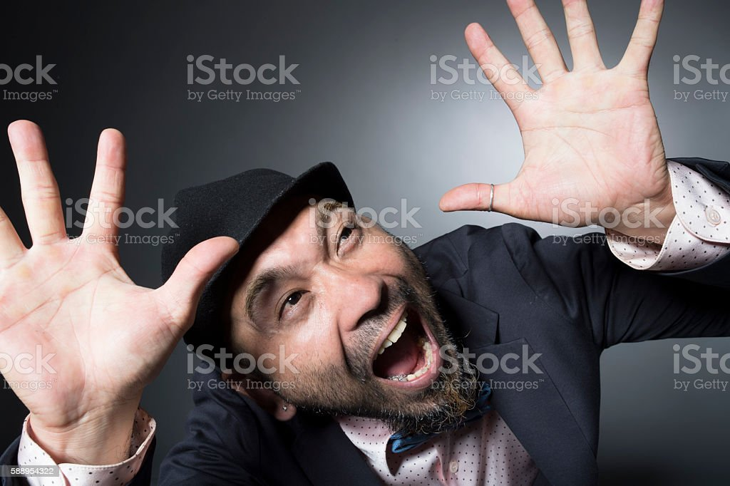 Men disappointed to have raised their hands stock photo