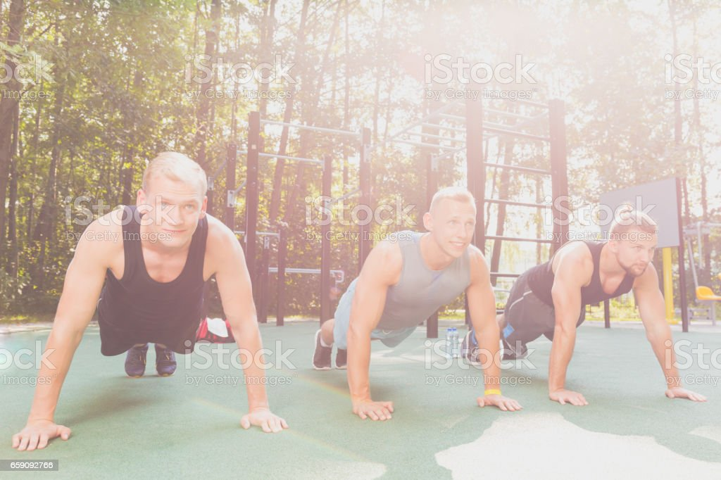 Men doing physical exercises stock photo