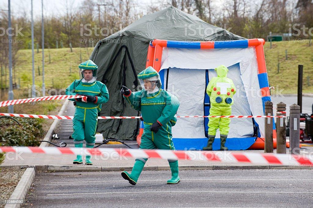 Men dressed in biological hazard suits in quarantine stock photo
