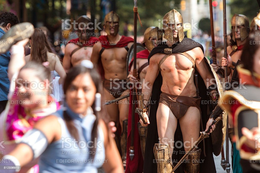 Men Dressed Like Spartan Warriors Walk In Dragon Con Parade stock photo