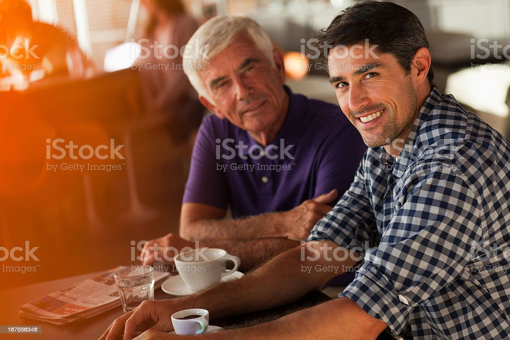 Men drinking coffee together in cafe royalty-free stock photo