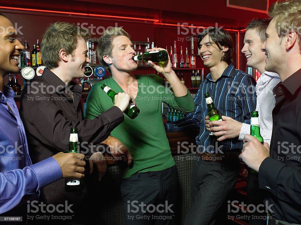 Men drinking in a bar stock photo
