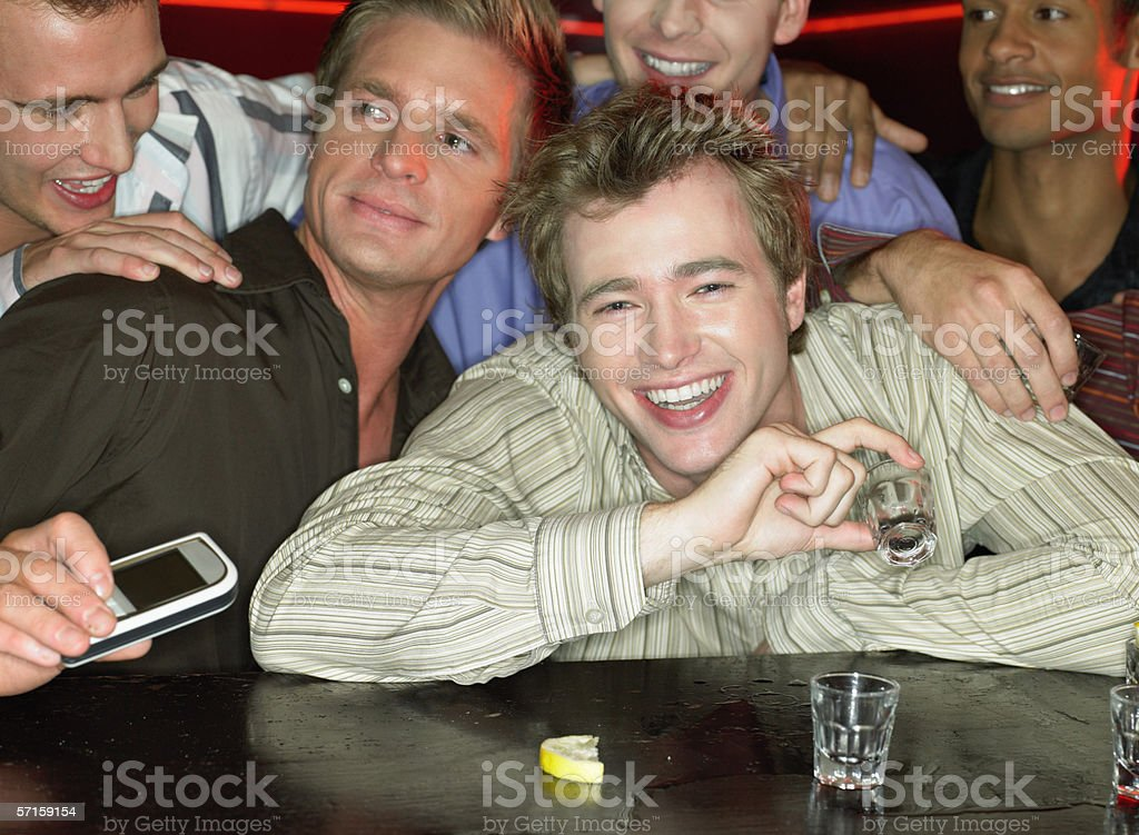 Men drinking shots at a bar royalty-free stock photo