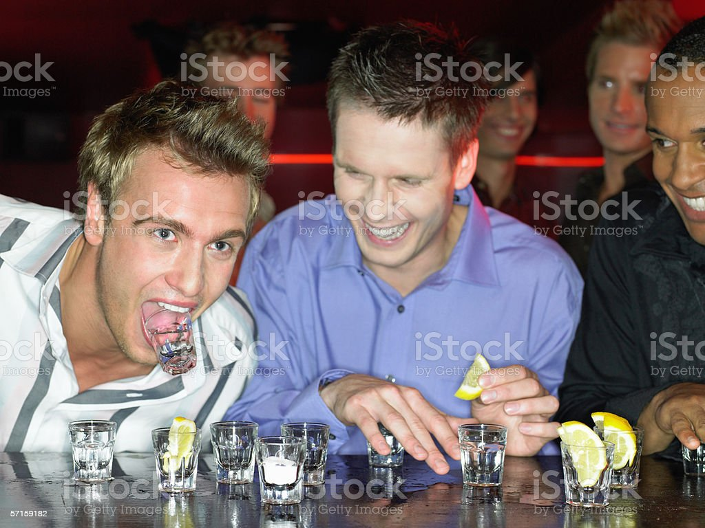 Men drinking shots at a bar royalty-free stock photo