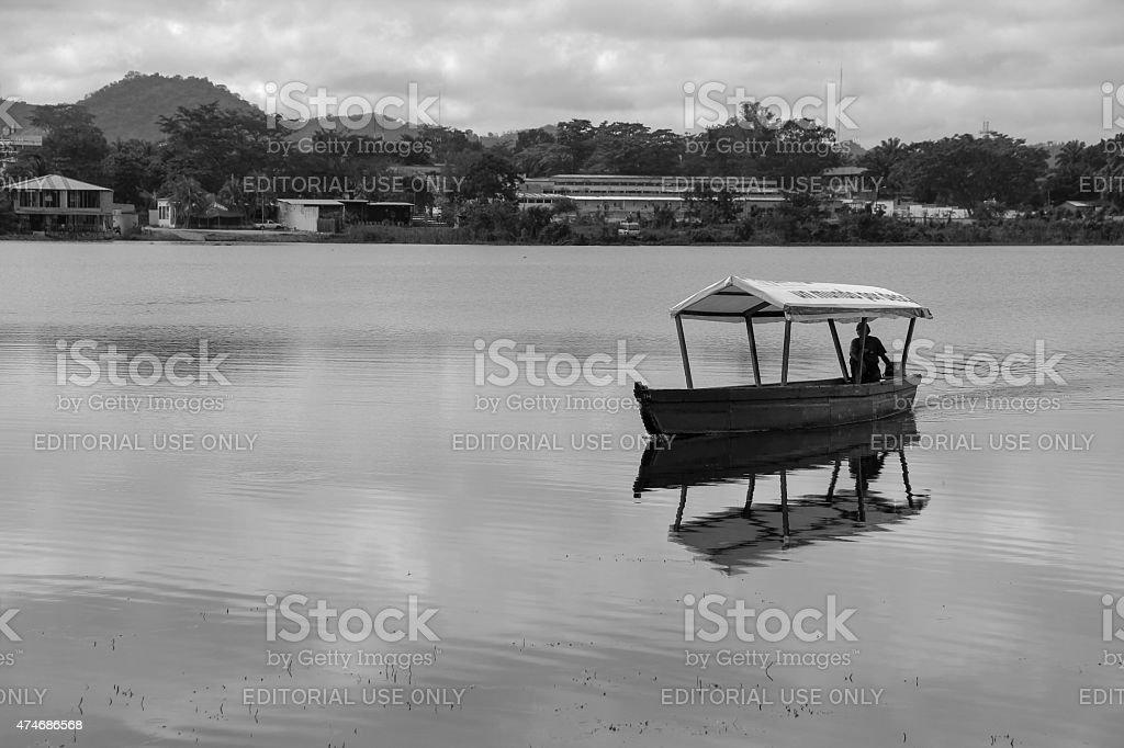 Men driving boat in Florez, Guatemala stock photo