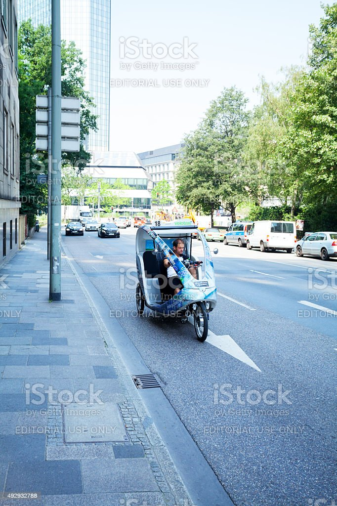 Men driving velo taxi in Frankfurt stock photo