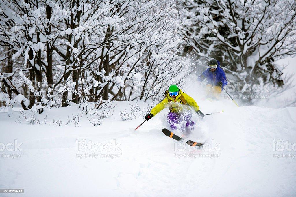 Men enjoying skiing stock photo