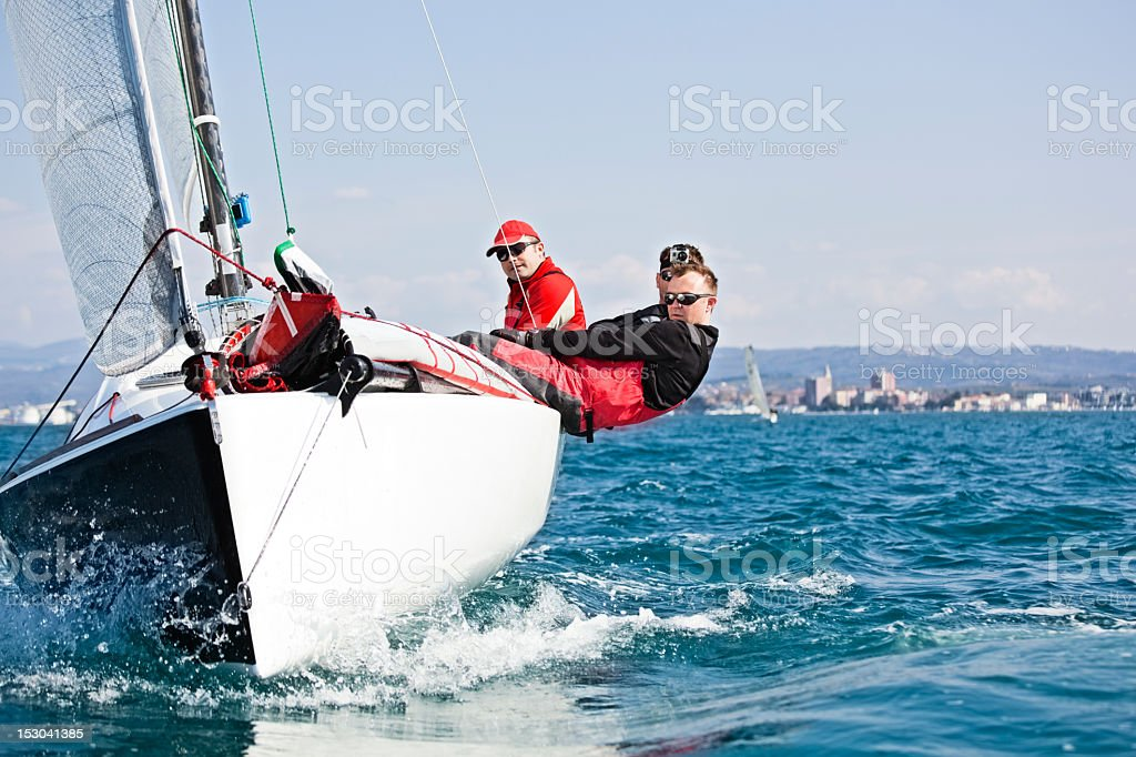 Men enjoying the sport of sailing stock photo