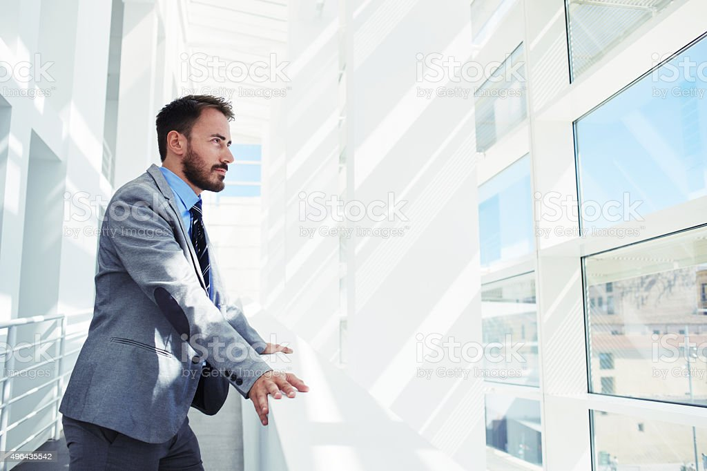 Men entrepreneur dressed in luxury clothes looking in office window stock photo