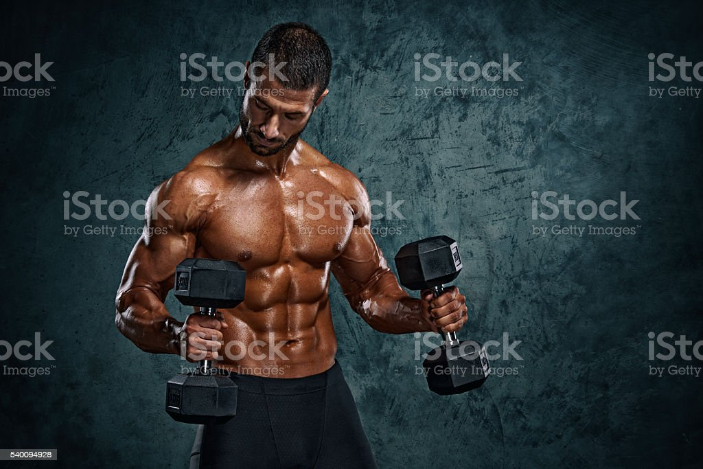 Men Exercise With Dumbbells stock photo