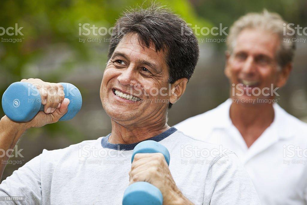 Men exercising outdoors stock photo