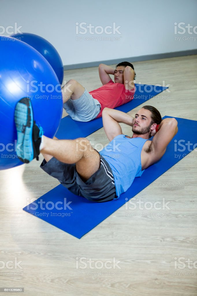 Men exercising with exercise ball royalty-free stock photo