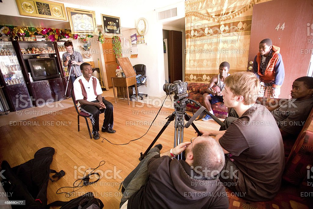 Men Filming Interview with Somali Refugee stock photo