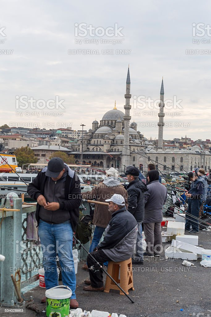 Men Fishing From Istanbul Bridge stock photo