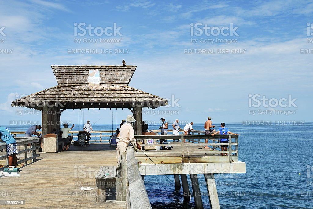 Men fishing from Naples pier in southwest Florida stock photo