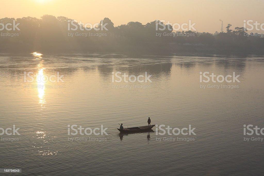 Men fishing on a boat stock photo