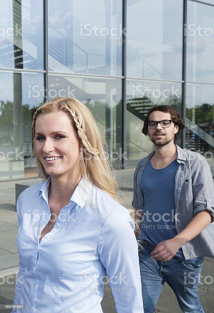 Men follows woman stock photo