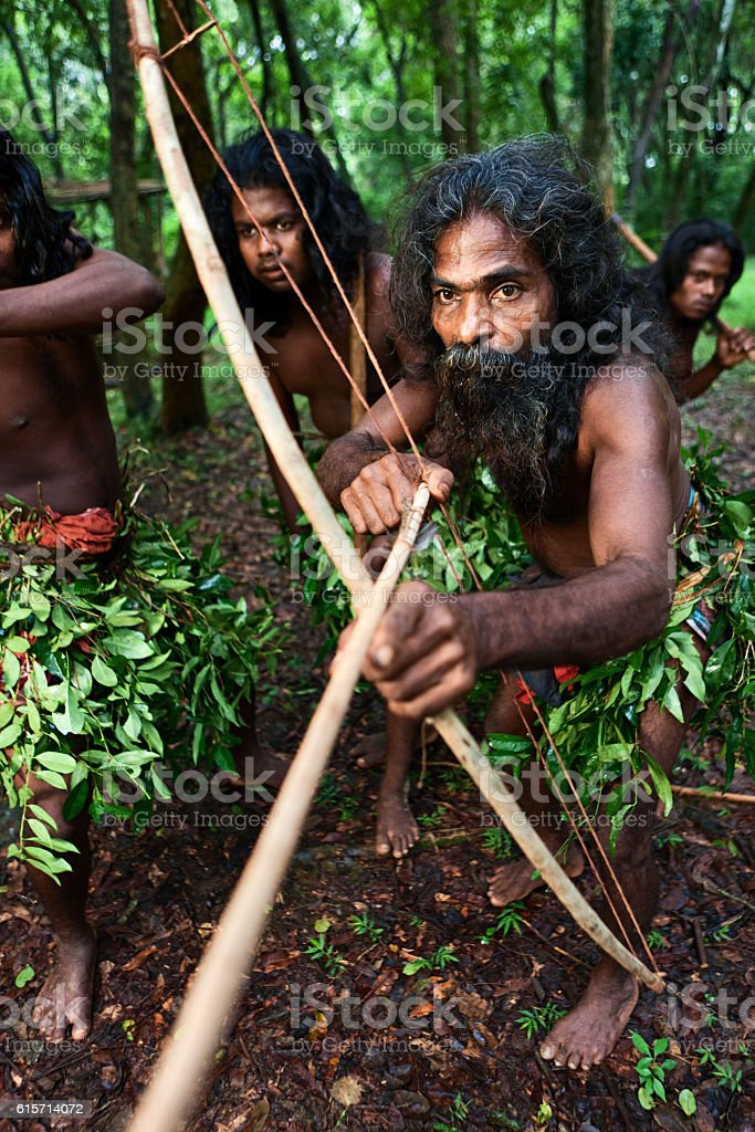 Men from Vedda tribe during the hunt, Sri Lanka stock photo
