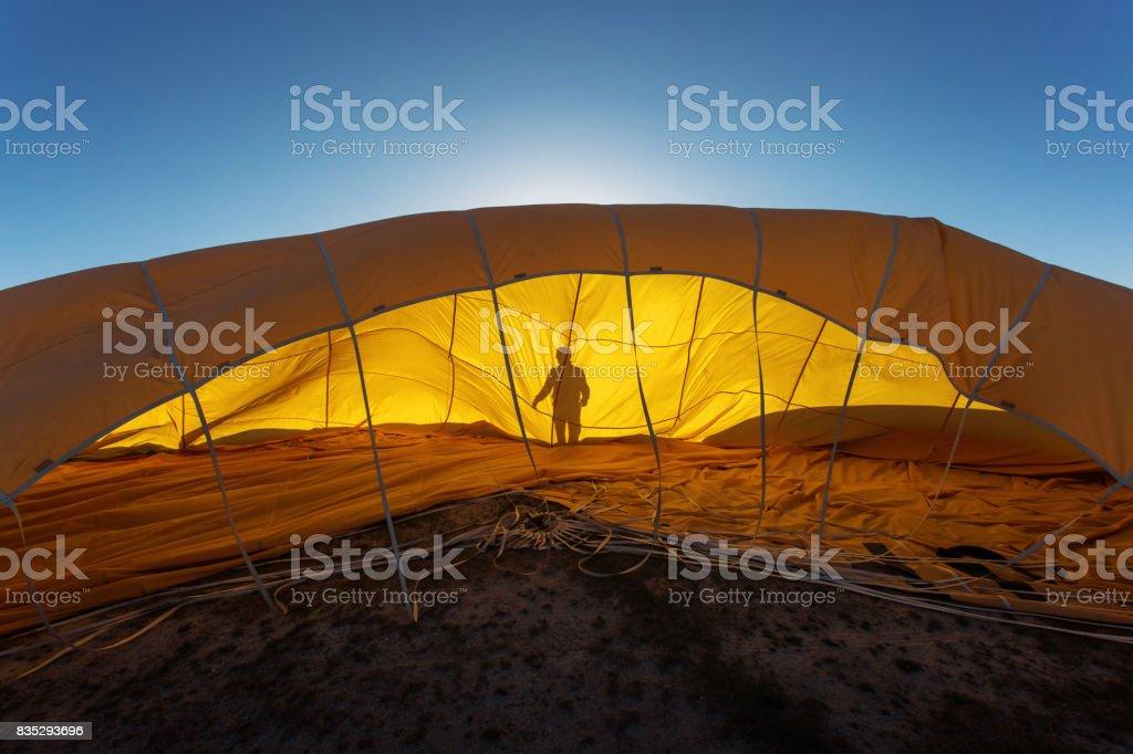 Men gathering the balloon after landing in Cappadocia, Turkey stock photo