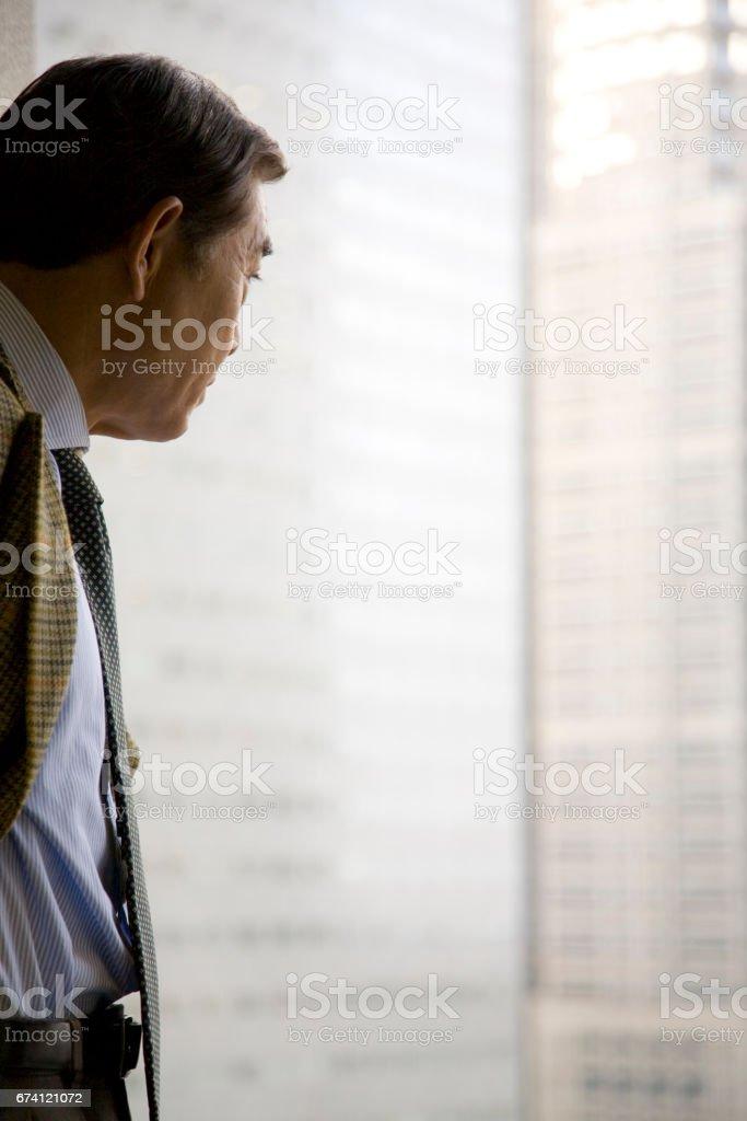 Men gaze out stock photo