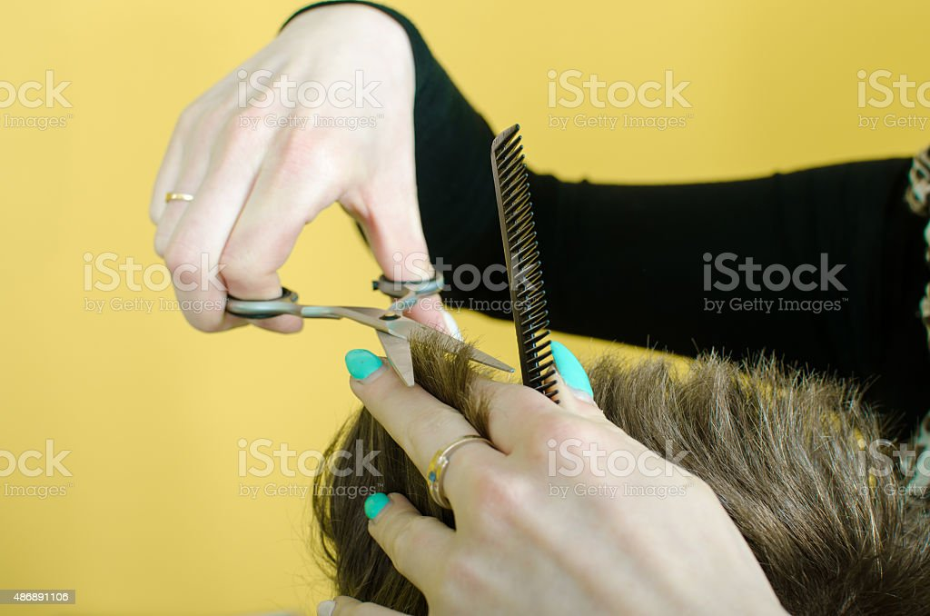 Men getting a haircut stock photo