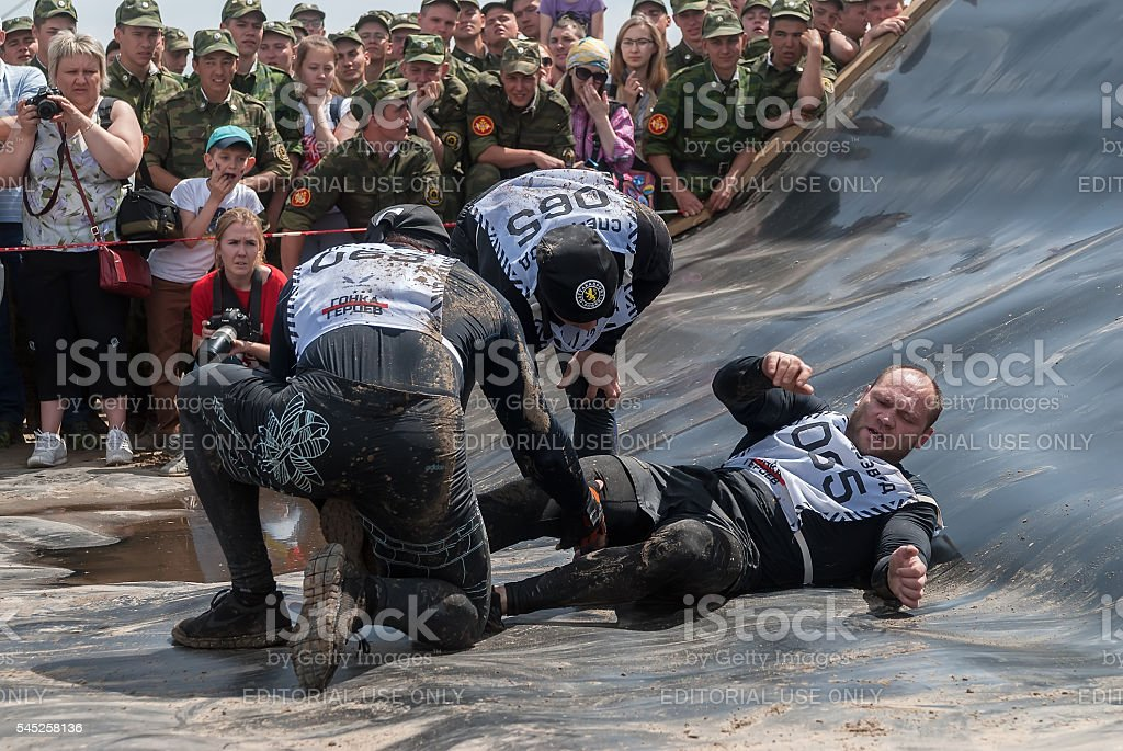 Men give first aid to companion on race. Tyumen stock photo