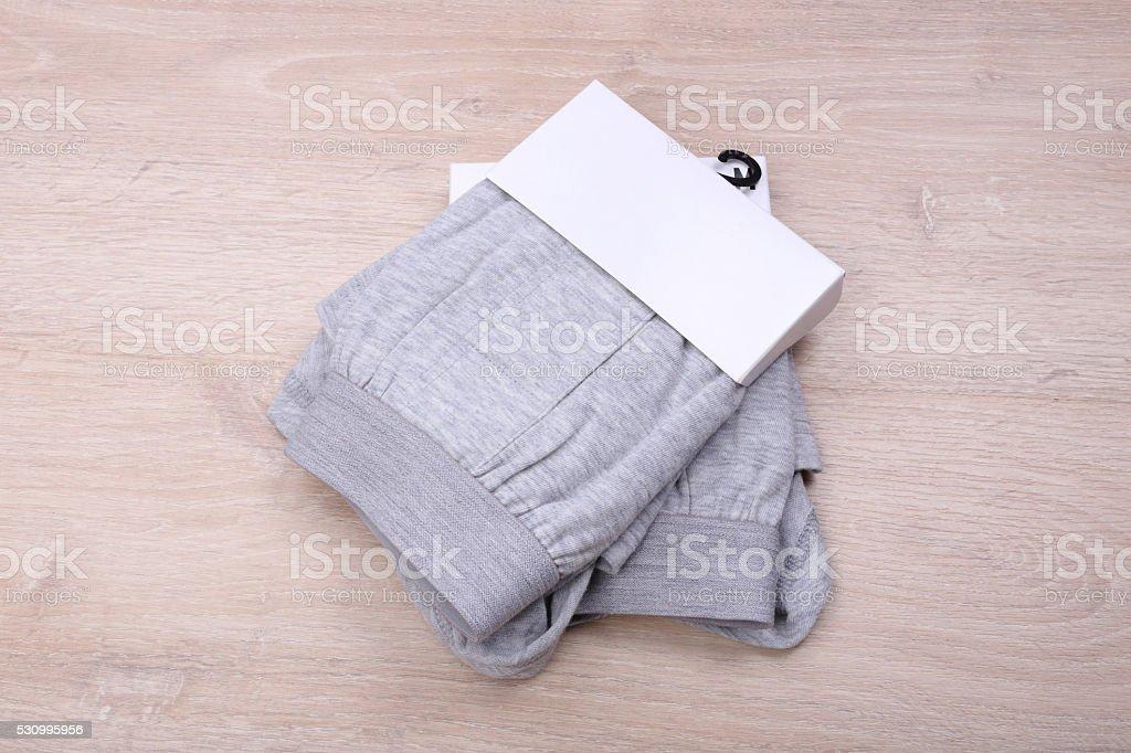Men gray boxer shorts on wooden background stock photo