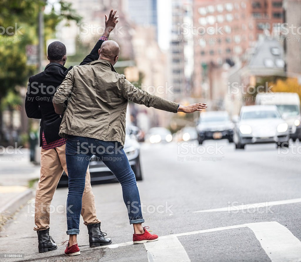 Men hailing a taxi in New York stock photo
