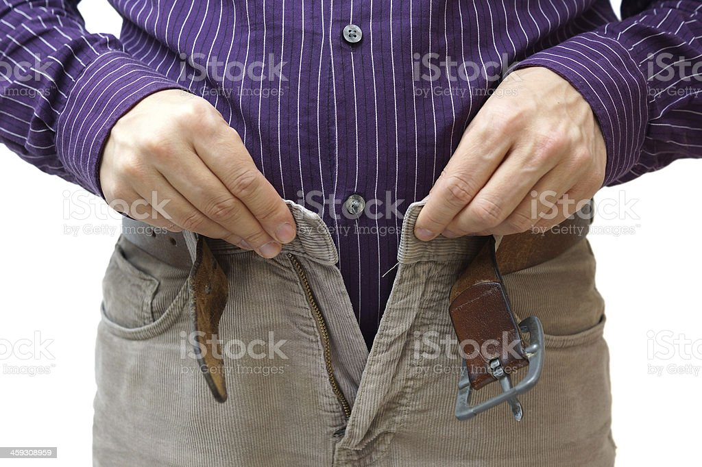 men hands unable to close the pants due gainingweight stock photo