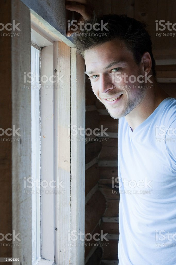 Men Hanging out in front of a window royalty-free stock photo