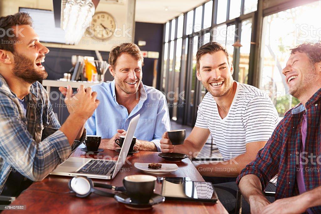 Men having fun at a coffee shop stock photo