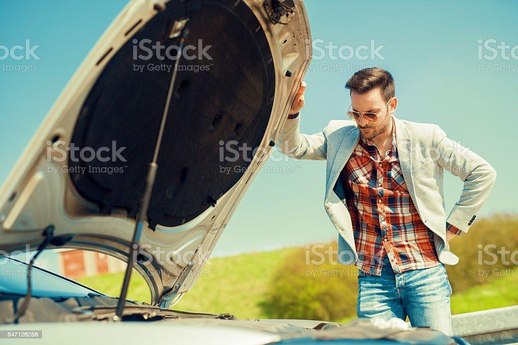 Men having problem with car. stock photo