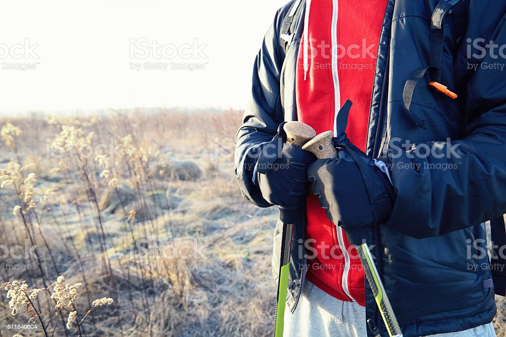 Men hiker hands with poles close up stock photo