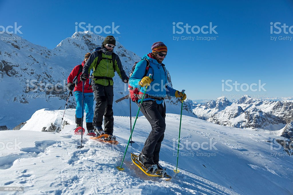 Men hiking on snow covered landscape stock photo