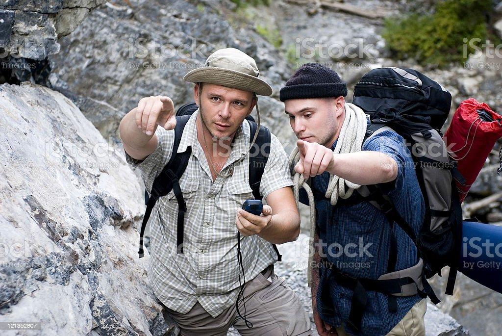 Men Hiking Using GPS Tracking royalty-free stock photo